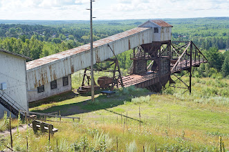 Photo: Old mining and ore-loading equipment. The headframe for the mine shaft is to the left off this photo.