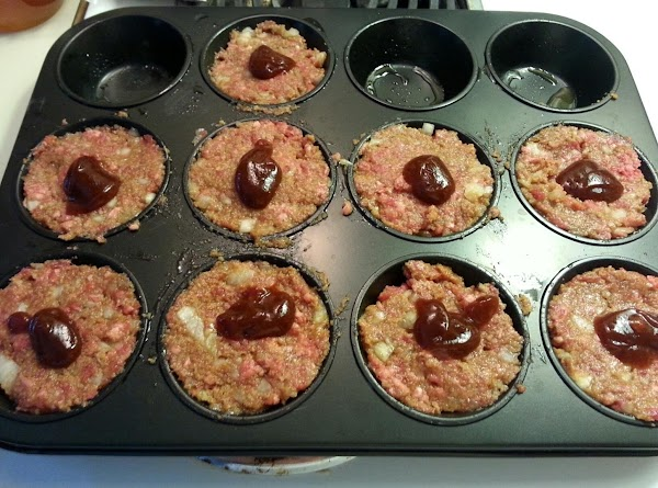 Add meatloaf to the top of each muffin cup, flattening out the tops. Top...