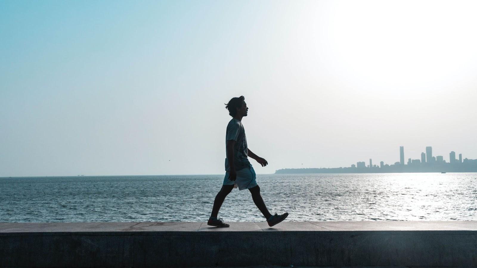 Person taking a walk near water
