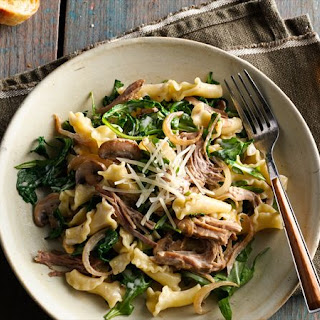 Creamy Pulled Pork Pasta with Caramelized Onions, Mushrooms and Arugula.