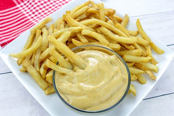 French Fry Dipping Sauce In A Bowl With A Plate Of French Fries.