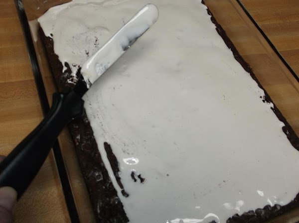 Stir marshmallow cream with a knife or small off-set spatula; evenly spread marshmallow cream...
