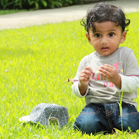 Go Green !!! by Aarthi Siva - Babies & Children Child Portraits ( wow, cute baby, park, nature, cute eyes, babies candid, green, beautiful, child portrait, baby, cute boy, surprised )