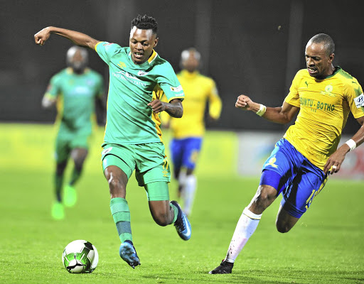 Richard Matloga of Baroka, left, is challenged by Tiyani Mabunda of Mamelodi Sundowns during their PSL clash at Lucas Moripe Stadium, Pretoria.