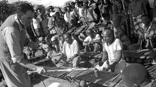 Value of foresight: Ethnomusicologist Hugh Tracey records an African xylophone as musicians play for the crowd. Starting in 1929, he produced the most extensive repository of African indigenous music and instruments. Picture: WIKIMEDIA COMMONS