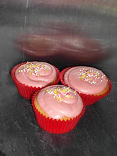 Photo: Vanilla cupcakes topped with pink vanilla cream cheese icing and sprinkles