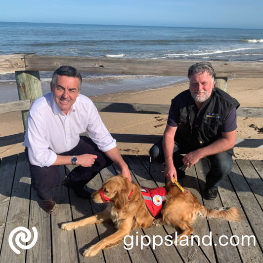 Federal Member for Gippsland Darren Chester meeting with Rosie the assistance dog and police veteran Dale Potter in Seaspray