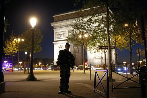 An armed soldier secures a side road near the Champs Elysees Avenue in Paris, after a policeman was killed and two others wounded in a shooting claimed by Islamic State on April 20 2017. Picture: REUTERS