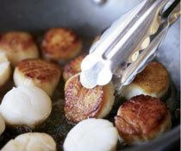 Wipe scallops with paper towels.Heat a 12 inch cast iron skillet(or other non stick...
