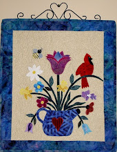 Photo: The second original design wall hanging by Trisha as part of a pair to put over the bed with the Bird Quilt.