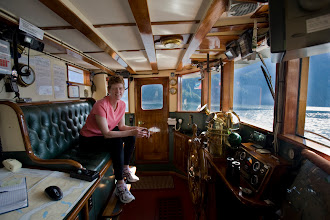 Photo: Karen in the wheelhouse (photo taken in 2008, last time we did the voyage).  Note all the shiny mahogany and brass.