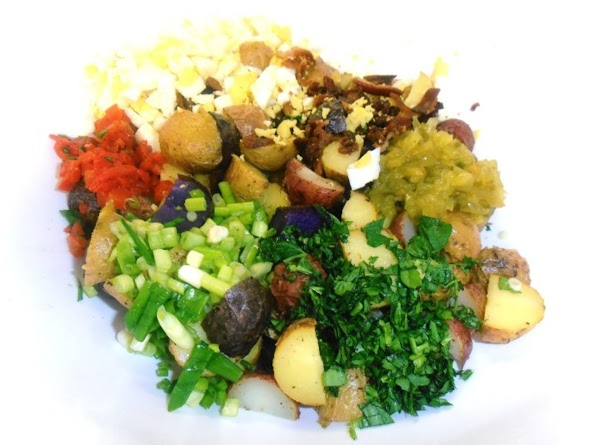 In a large mixing boil add potatoes, eggs, bacon, all the veggies and mayo...