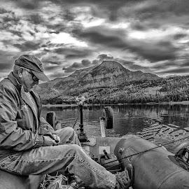 Tying the lure by Joe Saladino - Black & White Portraits & People ( fishing, monochrome, black and white, man, clouds, water, lake, boat )