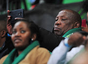 Nedbank KeYona mentor and former South Africa national team head coach Shakes Mashaba films the opening ceremony of the Nedbank Cup final between Maritzburg United and Free State Stars at Cape Town Stadium on May 19 2018.