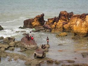 Photo: Kids playing on the rocks at Toubab Dialaw