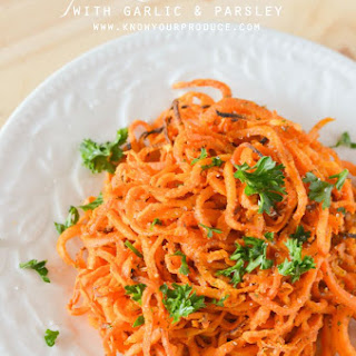 Baked Spiralized Sweet Potato Fries with Garlic and Parsley.