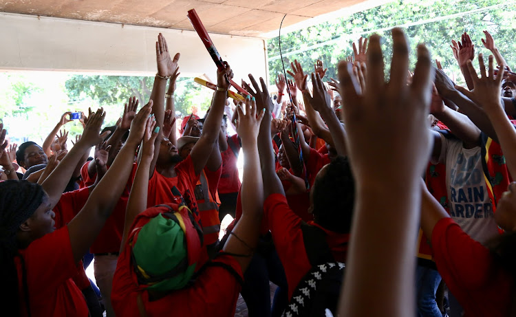 EFF members sing struggle songs at the DUT campus where student Mlungisi Madonsela was shot and later died during violent clashes between police and students.