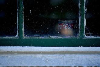 Photo: Coke under glass.