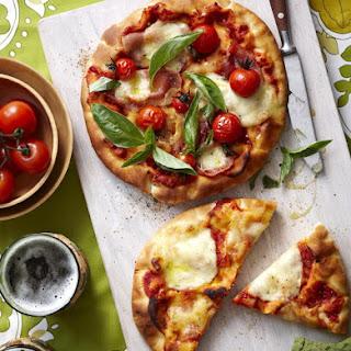 Mozzarella, Tomato and Prosciutto Pizzas