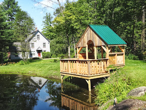 Photo: New Pond Deck and house with solar-powered night lighting