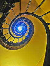 Photo: Spiral stairs in yellow and blue Seen in my hotel in Paris.