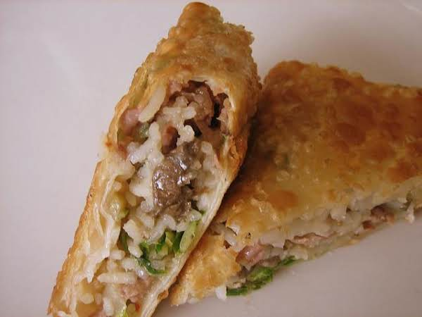 This Amazing Egg Roll Tastes Like Heaven In Your Mouth. Dipping It In The Chimichurri Sauce Just Brings Another Great Element To It. I Tried To Capture The Cuban Experience With These Egg Rolls ... Something Different!