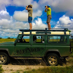 by Nora Richards - Transportation Automobiles ( adventure, tourists, zambia, binoculars, funny, tourism, travel, africa, landscape, people )