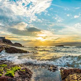 Sunrise in Ilhota Beach by Rqserra Henrique - Landscapes Beaches ( sunrise, rocks, beach, clouds, splash, wave, colorful, rqserra )