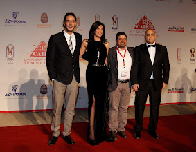 Photo: The opening of Decor at Cairo International Film Festival, The Red Carpet. Dir: Ahmad Abdalla with the Actress Horya Farghaly, Exc Producer Ahmed Badawy, and Khaled Abol Naga.