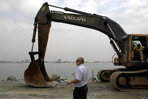 Economic erosion: Pierre Edde, development director of Eko Atlantic, stands on a wall built to stop coastal erosion where land reclamation is taking place as part of the Eko Atlantic city development project in Lagos, Nigeria. Picture: REUTERS