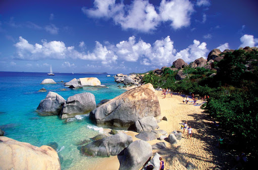 Visitors walk the beach during a shore excursion at The Baths on Virgin Gorda in the British Virgin Islands.