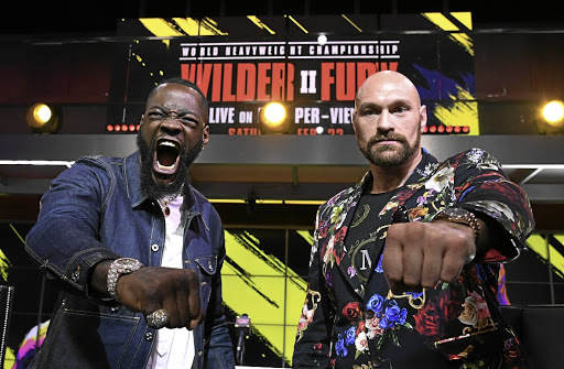 Deontay Wilder, left, and Tyson Fury will face off in their WBC heavyweight championship on Sunday.
