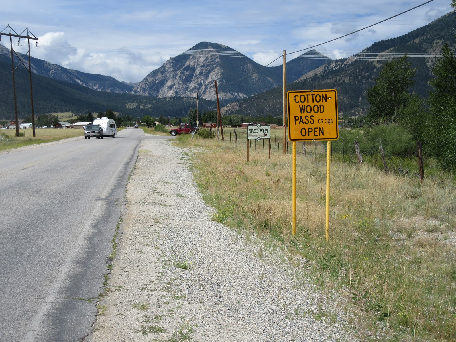 Cycling Cottonwood Pass  - roadway sign, highway and mountains