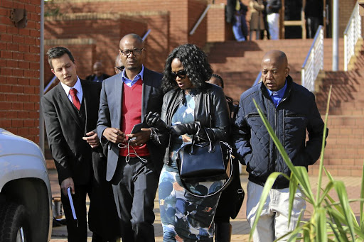 Media mogul Given Mkhari and his wife Ipeleng exit the Randburg Magistrate's Court in Johannesburg after the pair laid assault charges against each other following an alleged fight at the weekend.