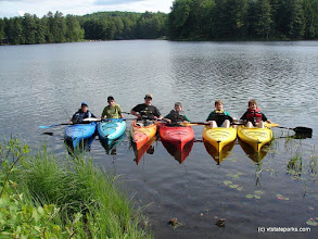 Photo: A rainbow of kayaks at Half Moon Pond State Park by Lisa Ann Munukka Frasier