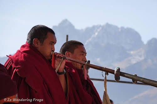 China Sichuan Kham Tibet Garze Ganzi Kandze Monastery Buddhist Festival // Monks Playing Traditional Music Horns