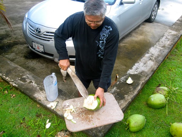 My dad, opening coconuts for our pancakes on a Sunday morning.