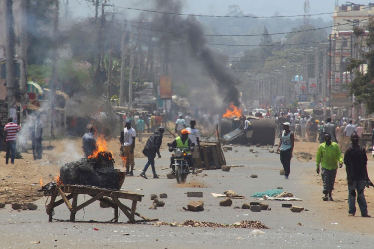 Demonstrators supporting opposition leader Raila Odinga set up barricades in Kisumu, Kenya, on Wednesday. Picture: REUTERS