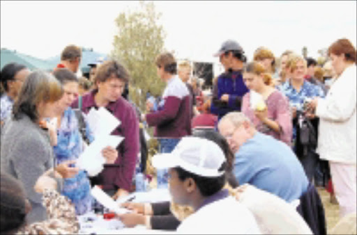 REACHING OUT: Bethlehem residents queue to register for social grants and IDs. Pic. Peggy Nkomo. 25/07/08. © Sowetan.
