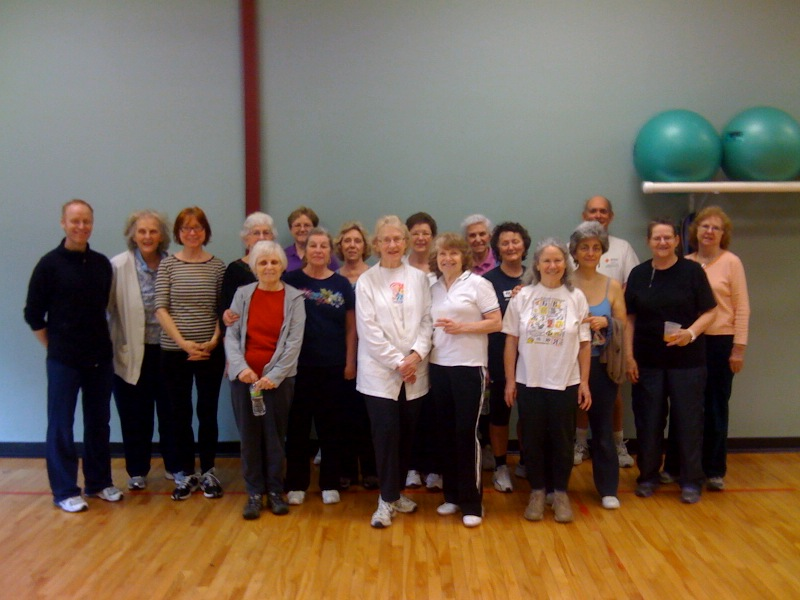 Seniors standing well from their pilates training, and good exercise habits