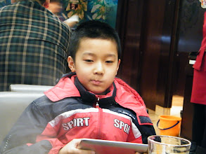 Photo: brought dearest son dined out with fried beef after a sore afternoon waiting before meeting my son, who brought away by his jealous mom, a bitchy small woman. we both liked the food, even son played a lot on his fonepad during dinner. here WOZ paused for a shot moment.
