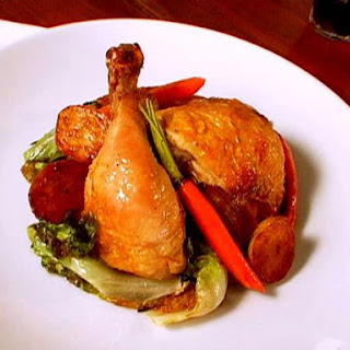 Roast Chicken with Potatoes and Vegetables.