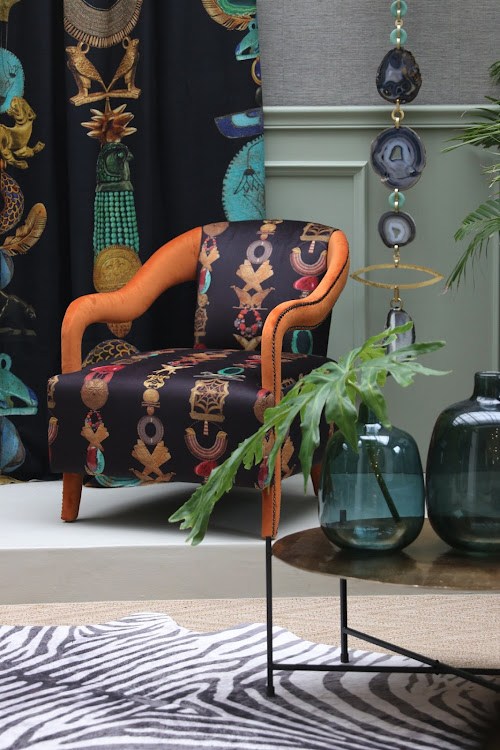 A chair upholstered in 'Mesopotamia', a fabric from Hetex x Envy & Co's 'Kingdom' range.