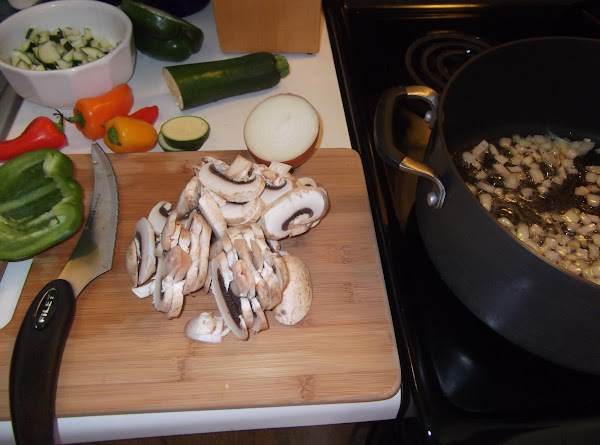 Sauté chopped onions in bacon fat until soft.