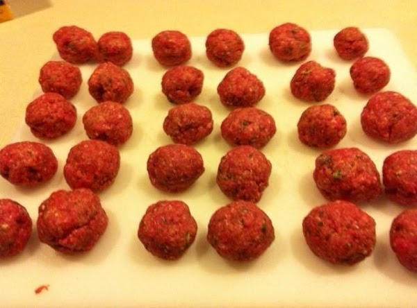 Pinch off and roll mixture into 1 1/2 inch meatballs (about 30 meatballs total).