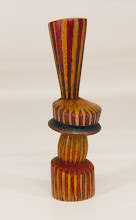 "Photo: Tina Chisena  1 3/4"" x 5 3/4"" colored, multi-axis vase [mahogany]"