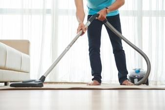 A picture containing person, floor, vacuum Description automatically generated