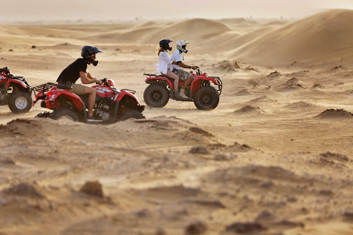 Explore the desert with friends on an ATV during winter in Dubai.