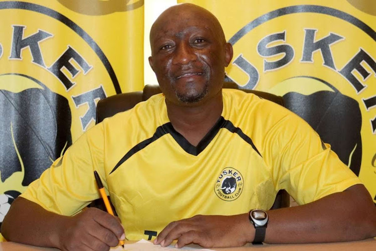 Newly appointed Tusker FC assistant coach George Maina signing his contract on Monday.