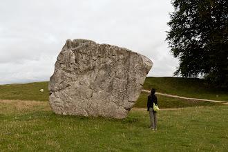 Photo: Examining one of the stones in Avebury circle